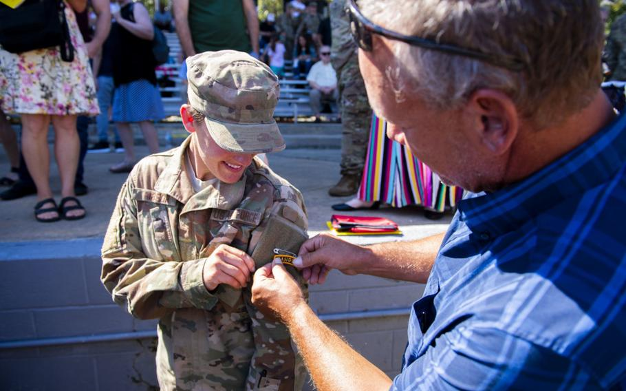 First Lt. Chelsey Hibsch receives her Ranger tab after graduating from the U.S. Army Ranger School Aug. 30, 2019, at Fort Benning, Ga.
