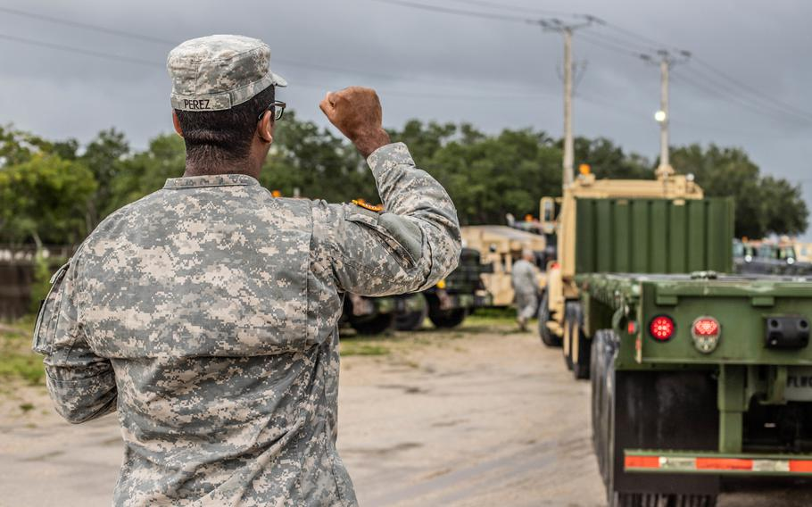 Florida National Guardsman Sgt. Eliezer Perez, a truck driver from the 12-18th Transportation Company, West Palm Beach, Florida, ground-guides an A5 truck, Sept. 2, 2019. The 12-18th is preparing to distribute supplies in support of Hurricane Dorian.