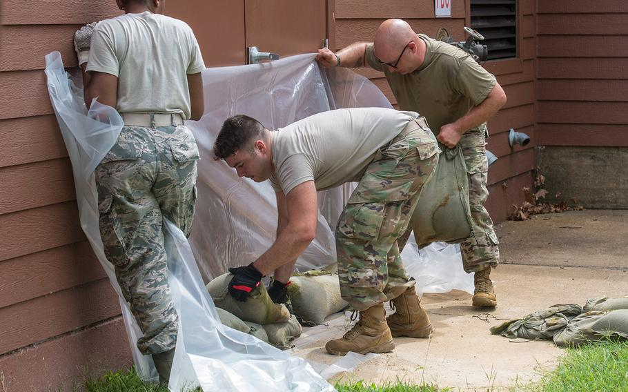 U.S. Air Force Airmen set up sandbags in preparation for Hurricane Dorian at Joint Base Langley-Eustis, Va., Sept. 5, 2019. Entryways and vents at buildings across the installation were sealed with sandbags in response to flood projections.