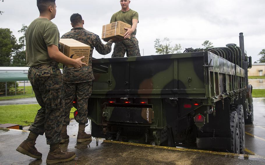 U.S. Marines with Marine Corps Air Station New River load Meals Ready to Eat onto a medium tactical vehicle replacement at station supply on MCAS New River, North Carolina, Sept. 5, 2019. Marines work to ensure all equipment and personnel are prepared for the upcoming heavy rains, strong winds, and flash flooding associated with Hurricane Dorian.
