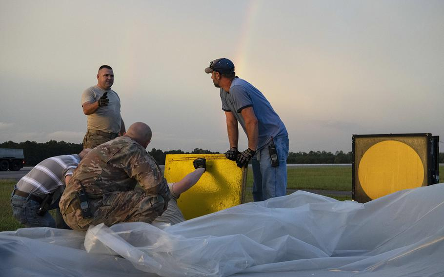 Members from the 4th Civil Engineer Squadron set up a generator for an aircraft arresting system ahead of Hurricane Dorian September 5, 2019, at Seymour Johnson Air Force Base, N.C. The AAS uses a special cable and belt system to stop jets if their brakes fail.