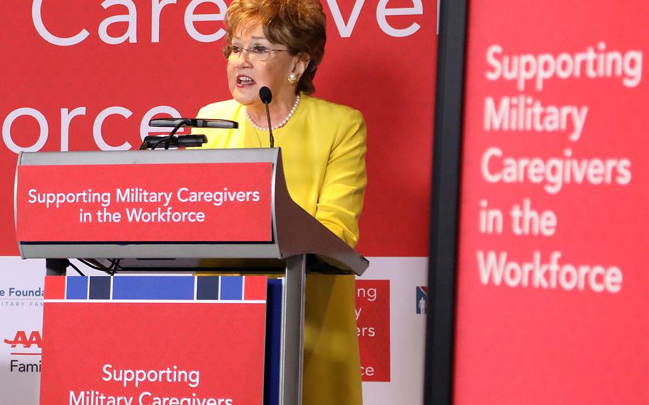 """Former Sen. Elizabeth Dole speaks before an audience of companies and military and veteran caregivers at the """"Supporting Military Caregivers in the Workforce"""" summit hosted Tuesday by the Elizabeth Dole Foundation, AARP, and the U.S. Chamber of Commerce's Hiring Our Heroes foundation in Washington, D.C."""
