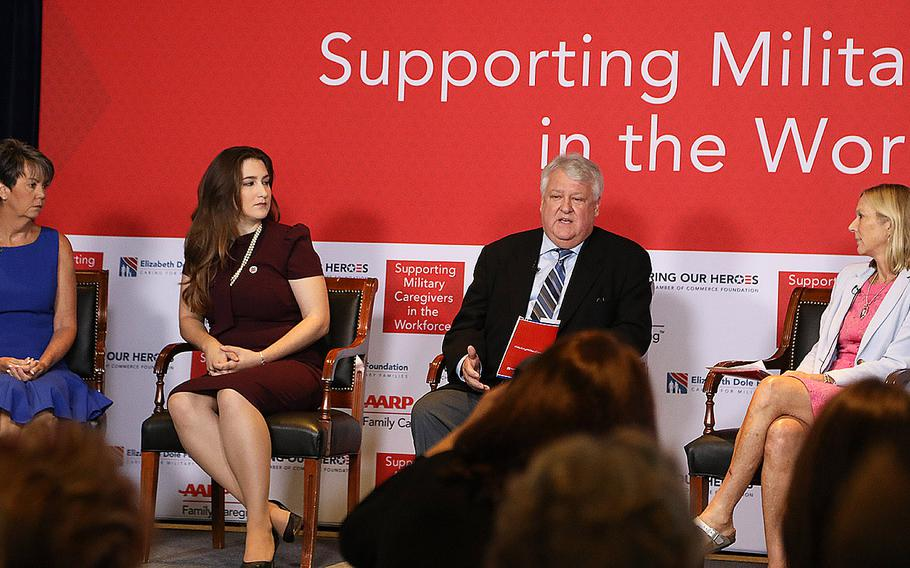 """Craig Remsburg speaks about caring for his son, a wounded veteran, during a caregiver panel Tuesday at the """"Supporting Military Caregivers in the Workforce"""" summit hosted by the Elizabeth Dole Foundation, AARP, and the U.S. Chamber of Commerce's Hiring Our Heroes foundation in Washington, D.C."""