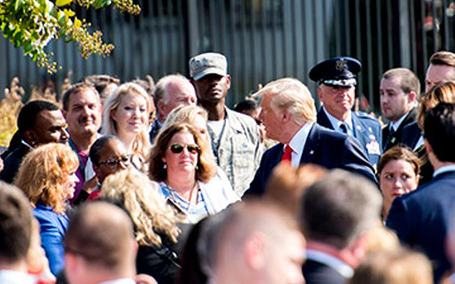 President Donald Trump greets family members of those killed in the 9/11 attacks, survivors of the attack on the Pentagon, and servicemembers after speaking at the Pentagon on Wednesday, Sept. 11, 2019 -- the 18th anniversary of the attacks.