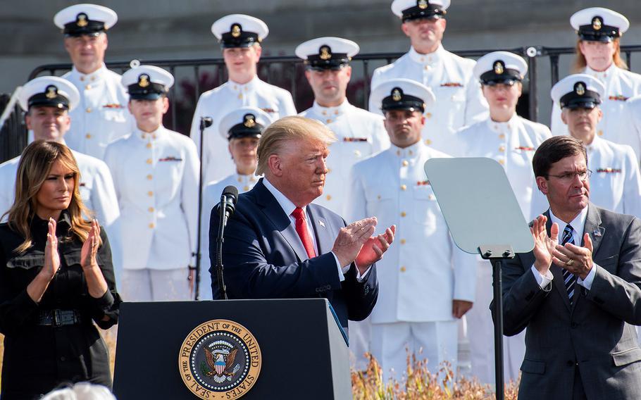 President Donald Trump, Defense Secretary Mark Esper, and Melania Trump applaud during a ceremony Wednesday, Sept. 11, 2019 at the Pentagon commemorating the 9/11 terrorist attacks.