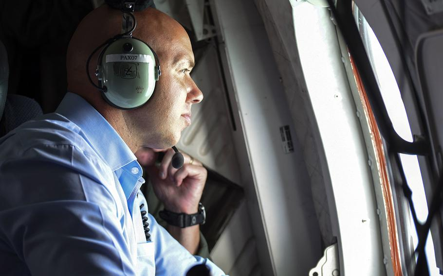 Rep. Brian Mast, R-Fla., looks out the window of a Coast Guard Air Station Miami HC-144 Ocean Sentry aircraft off the coast of Palm Beach, Fla., on Sept. 12, 2017. Mast flew with the Coast Guard for an overflight assessment of south Florida following Hurricane Irma.