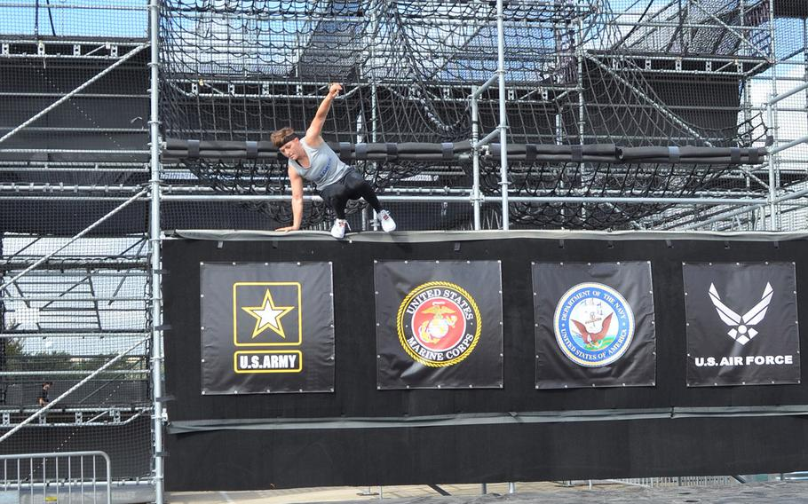 Air Force 2nd Lt. Michelle Strickland of Columbus Air Force Base, Miss., jumps down to the finish line of the Alpha Warrior Proving Ground in San Antonio on Thursday. She placed second among Air Force women at the event.