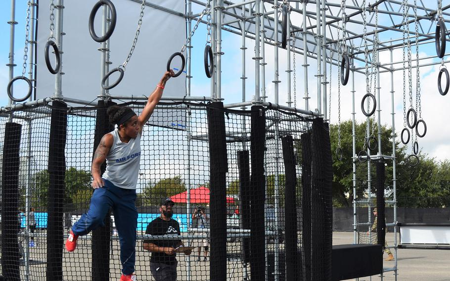 Air Force Airman 1st Class Elizabeth Jackson of Peterson Air Force Base, Colo., swings through an obstacle at the Alpha Warrior Proving Ground in San Antonio on Thursday.