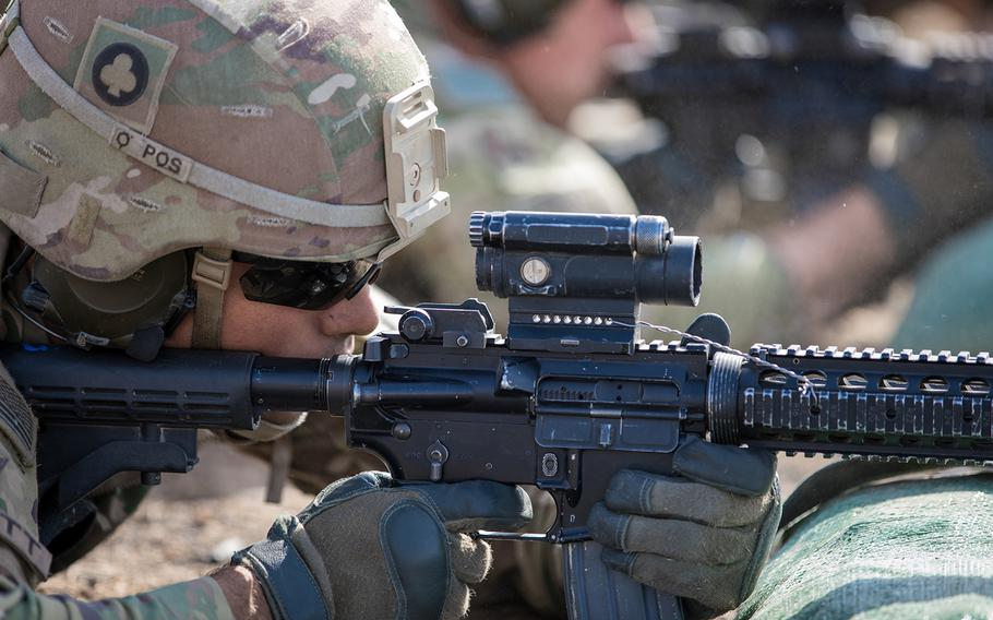 A soldier fires an M4 carbine, the military's version of Colt's AR-15, at a range on Qayyarah West Airfield, Iraq, June 4, 2019.