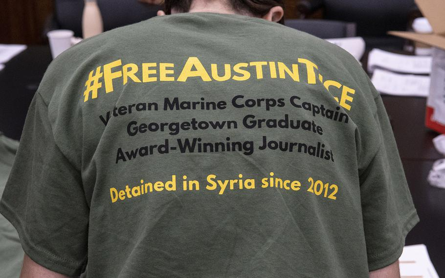 A t-shirt worn by a volunteer on Capitol Hill on Sept. 23, 2019 gives details about Austin Tice, a journalist who has been missing in Syria for seven years.