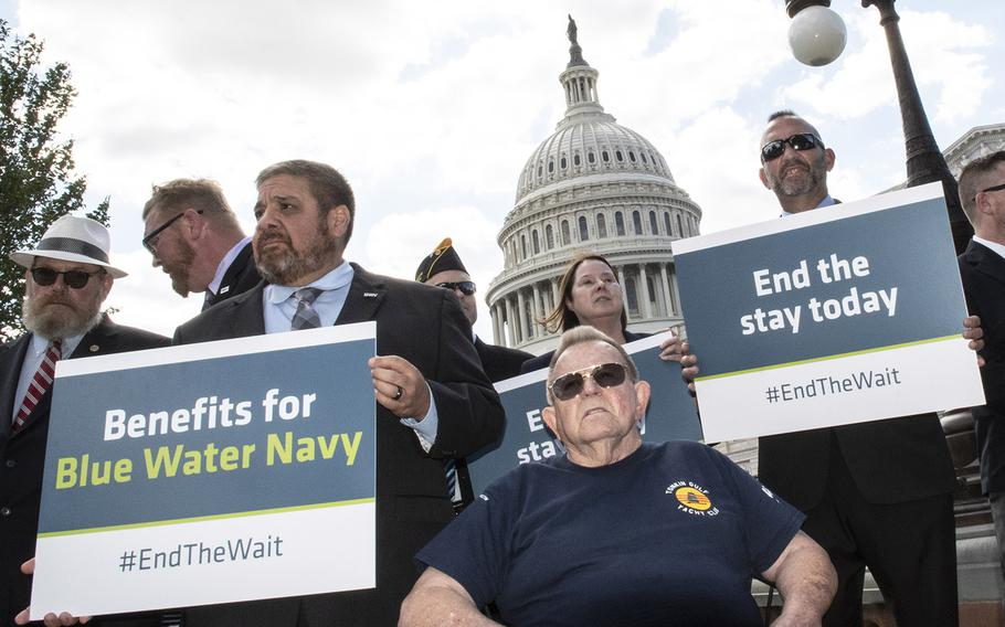 Bobby Daniels, foreground, and other veterans await the start of a Sept, 24, 2019 Capitol Hill press conference during which lawmakers and veterans urged urged the administration to provide health care and benefits to Vietnam-era veterans living with the effects of exposure to Agent Orange.