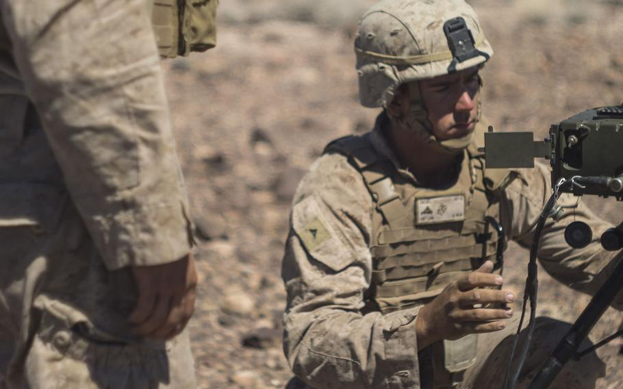 Then-Lance Cpl. Derek Diesel, prepares a portable laser designator to sight in on a target during an exercise on June 17, 2016.