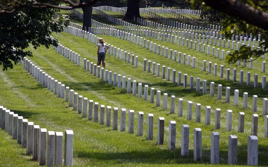 A guest visits graves at Arlington National Cemetery in Virginia in an undated photo.