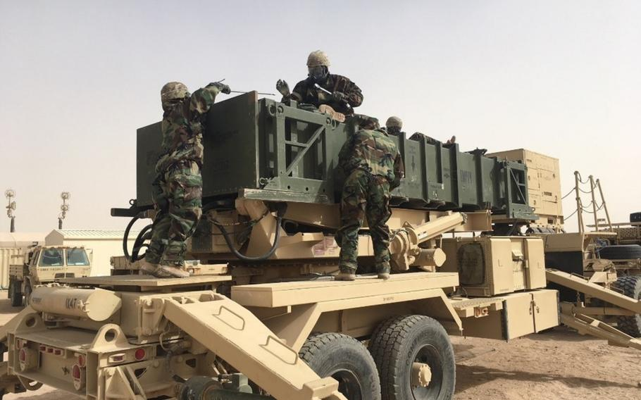 Soldiers take part in a Patriot missile reloading exercise at Camp Buehring, Kuwait, on January 16, 2018. Amid rising tensions with Iran, a Patriot missile battery will be sent to Saudi Arabia, the Pentagon says.