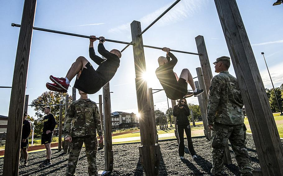 In a Oct. 23, 2018 file photo, soldiers assigned to the 128th Aviation Brigade at Fort Eustis, Va., attempt the leg tuck portion of the Army's new Army Combat Fitness Test.