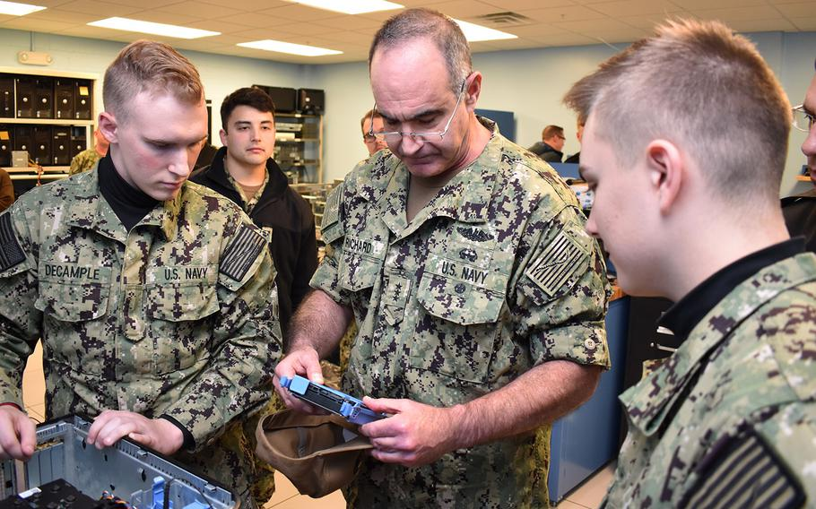 In a Nov. 14, 2018 photo, Vice Adm. Charles A. Richard, commander of Naval Submarine Forces, examines computer parts with Naval Submarine School students during a tour of the SUBSCOL campus on Naval Submarine Base New London, Conn.