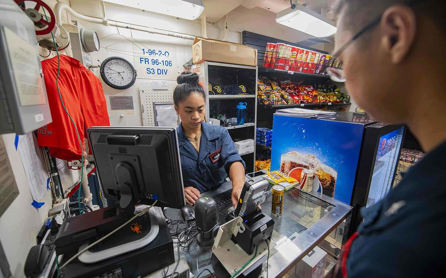 Seaman Epifania Hisatake works in the ship's store aboard the guided-missile destroyer USS McCampbell.