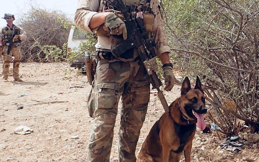Staff Sgt. Alex Schnell, with Bass on patrol in Somalia.