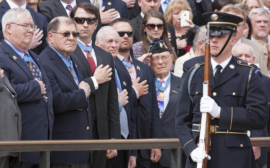 Medal of Honor recipients watch the Changing of the Guard at the Tomb of the Unknown Soldier in Arlington National Cemetery during Medal of Honor Day, March 25, 2016.