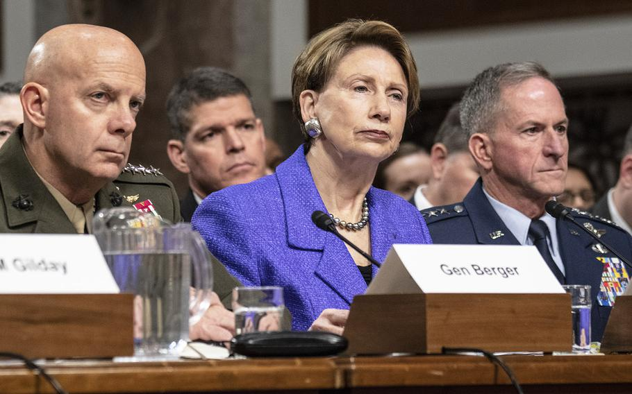 Marine Corps Commandant Gen. David H. Berger, Air Force Secretary Barbara M. Barrett and Air Force Chief of Staff Gen. David L. Goldfein, left to right, listen during a hearing on privatized military housing, December 3, 2019, on Capitol Hill.