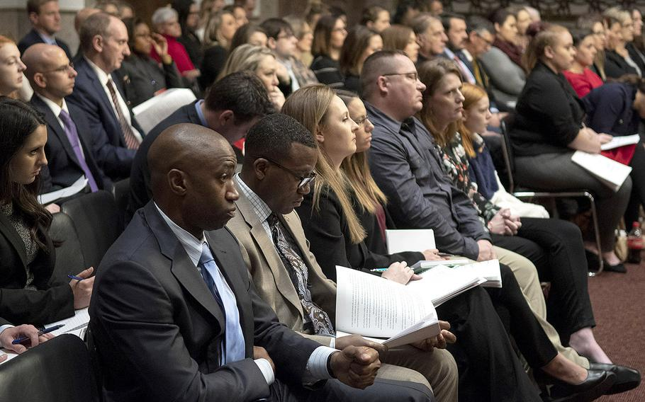 Audience members listen during a hearing on privatized military housing, December 3, 2019, on Capitol Hill.