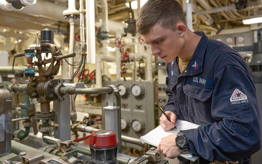 Engineman 2nd Class William Kerr records a pressure reading aboard the Arleigh Burke-class guided-missile destroyer USS Russell, Nov. 29, 2019, as the ship conducts routine training in the eastern Pacific Ocean.