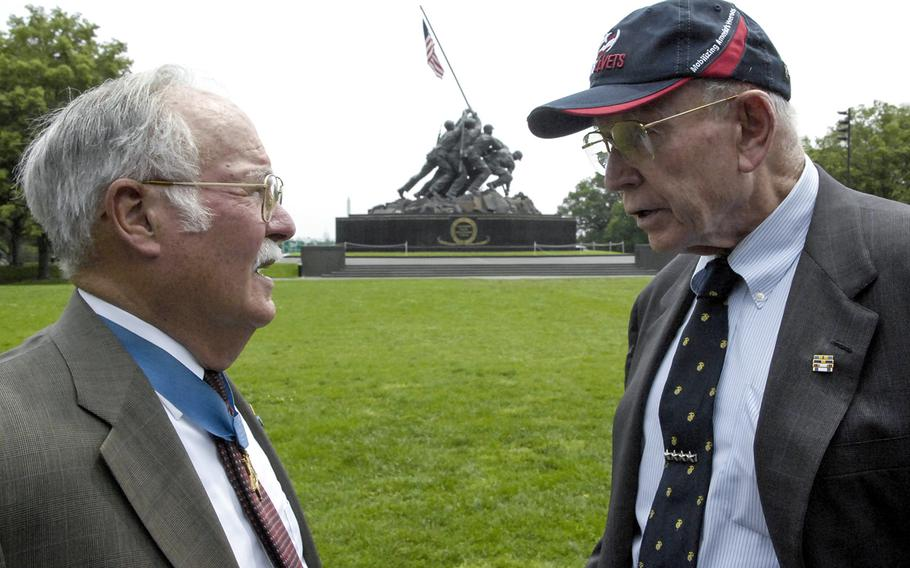 """Retired Gen. P.X. Kelley, right, talks with Medal of Honor recipient Harvey C. """"Barney"""" Barnum Jr. at the U.S. Marine Corps War Memorial in Arlington, Va., in May, 2012. Kelley, the 28th commandant of the Marine Corps, died December 29, 2019."""