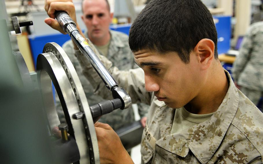 In an October, 2015 file photo, a Royal Saudi Air Force airman gets some hands-on practice working on a General Electric F-110 jet engine during class hours before his final examination, Oct. 1, 2015, at Sheppard Air Force Base, Texas.