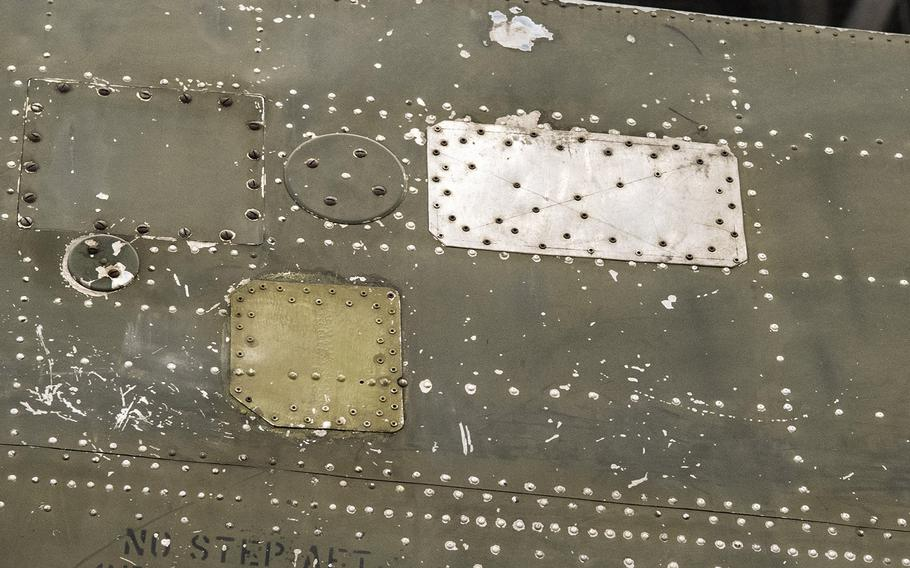 """Part of the patched Martin B-26B-25-MA Marauder """"Flak-Bait,"""" being restored at the Smithsonian's Udvar-Hazy Center in January, 2020. In all, the plane was hit by over 1,000 pieces of flak and shrapnel that required such repairs."""