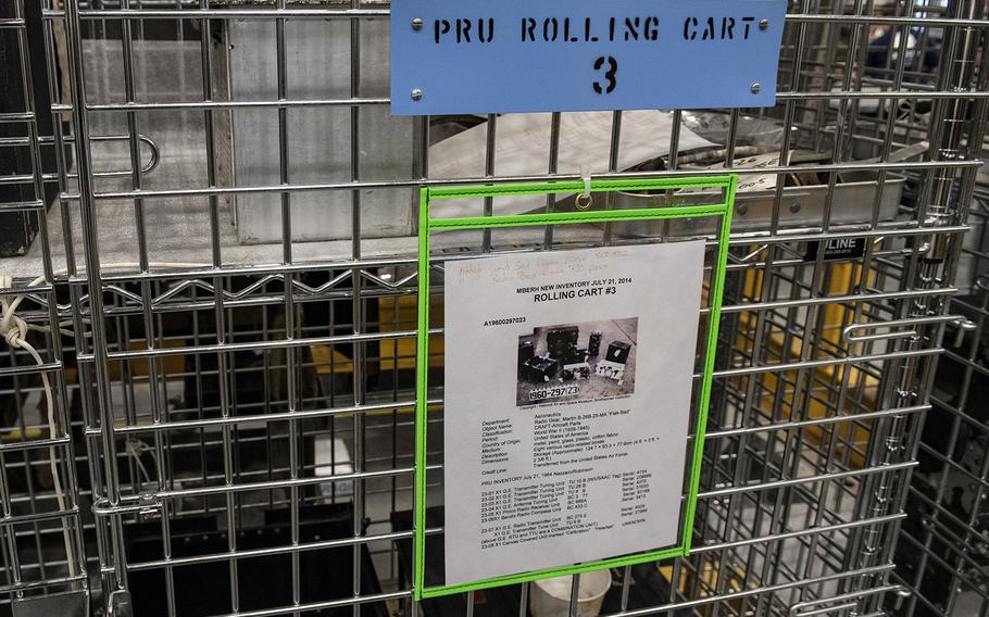 """Information on a storage cart indicates that it contains radio equipment from the Martin B-26B-25-MA Marauder """"Flak-Bait,"""" being restored at the Smithsonian's Udvar-Hazy Center in January, 2020."""