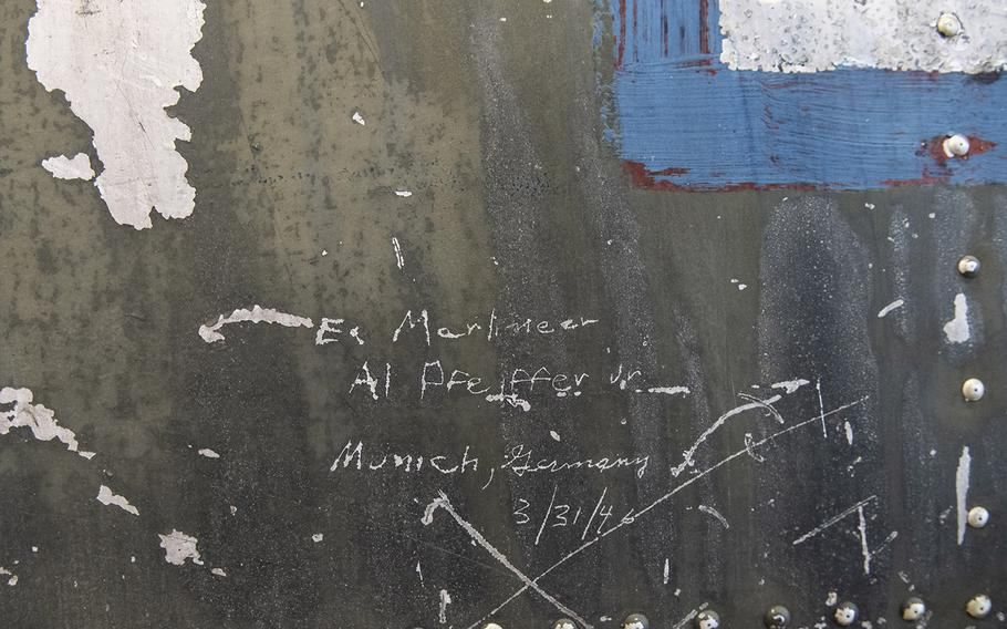 """Signatures adorn the fuselage of the Martin B-26B-25-MA Marauder """"Flak-Bait,"""" being restored at the Smithsonian's Udvar-Hazy Center in January, 2020."""