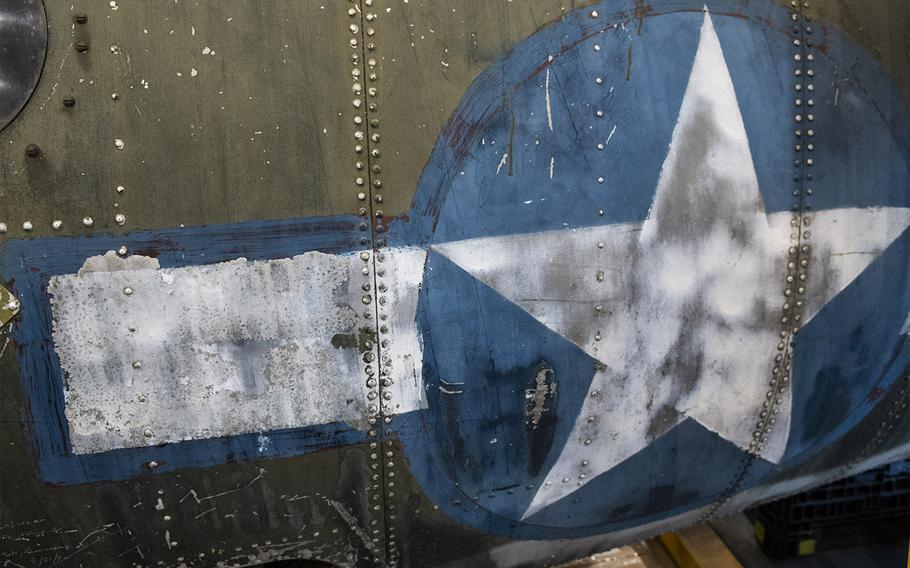"""The U.S. national insignia on the Martin B-26B-25-MA Marauder """"Flak-Bait,"""" being restored at the Smithsonian's Udvar-Hazy Center in January, 2020. Along the edges are blue lines that replaced the red ones on an earlier version of the insignia."""