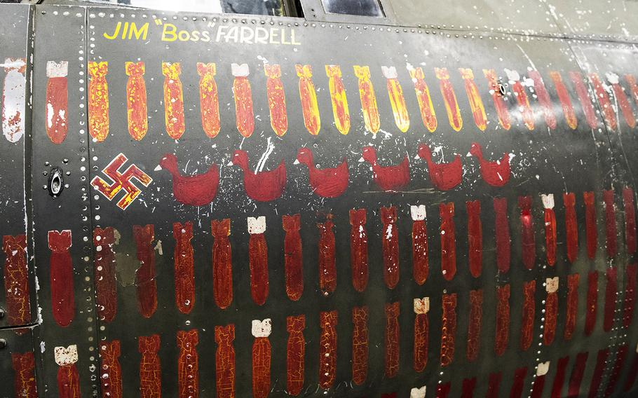"""Nose art on the Martin B-26B-25-MA Marauder """"Flak-Bait,"""" being restored at the Smithsonian's Udvar-Hazy Center in January, 2020. Lt. James J. """"Boss"""" Farrell of Greenwich, Conn., flew more missions in """"Flak-Bait"""" than any other pilot; he named the bomber after """"Flea Bait,"""" his brother's nickname for the family dog. THe swastika represents the plane's lone confirmed kill; thed ducks represent missions where """"Flak-Bait"""" was used as a decoy to lure the Luftwaffe away from the real target."""