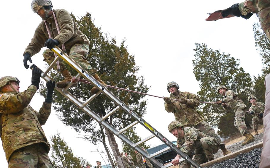 Candidates attempt to traverse an obstacle at the Leader Reaction Course during the Battalion Commander Assessment Program Jan. 23, 2020, at Fort Knox, Ky. The Battalion Commander Assessment Program is designed to determine fitness for command and potential.