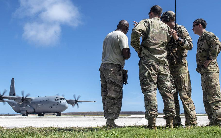 Members from the 36th Contingency Response Group from Andersen Air Force Base, Guam, discuss air operations during Super Typhoon Yutu relief operatioins in Saipan, Commonwealth of the Northern Mariana Islands, on Oct. 31, 2018.