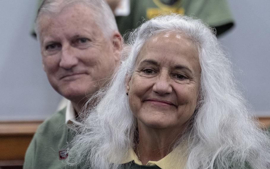 Marc and Debra Tice, parents of Austin Tice, listen as Julie Moos gives instructions to volunteers who are about to distribute information about the missing journalist to Capitol Hill offices, Sept. 23, 2019.