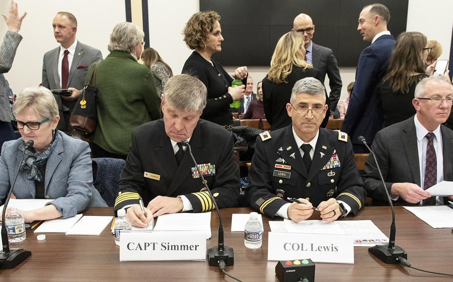 Awaiting the start of the second panel of a Feb. 5, 2020 House hearing on the Exceptional Family Member Program on Capitol Hill are, left to right, Carolyn Stevens, director of the DOD's Office of Military Family Readiness Policy; Capt. Edward Simmer, chief clinical officer for Tricare health plans at the Defense Health Agency; Col. Steve Lewis, deputy director of the Army's Quality of Life Task Force and Army family advocacy program manager; and Ed Cannon, director of fleet and family readiness at the Navy Installations Command.