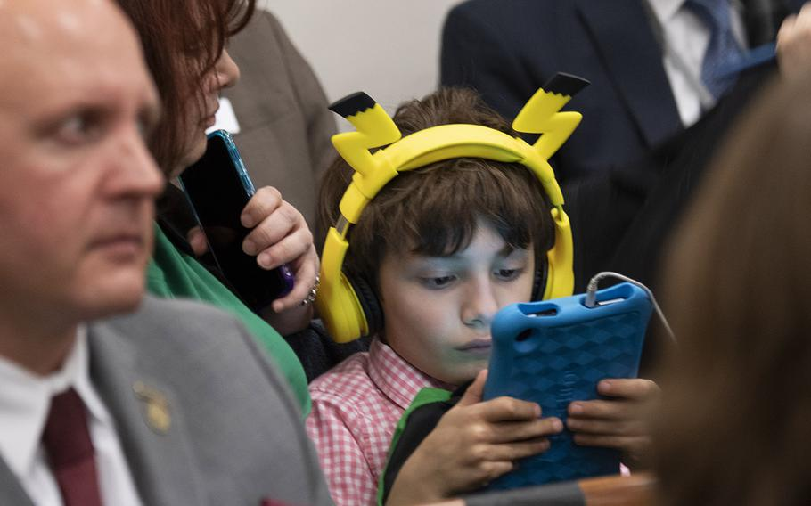 A young visitor to the hearing room passes the time before the arrival of the second panel at a House hearing on the Exceptional Family Member Program, Feb. 5, 2020 on Capitol Hill.