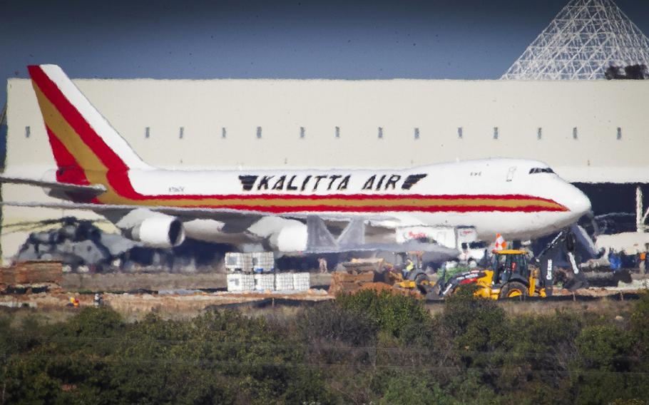 The second flight of U.S. citizens fleeing the coronavirus in China to arrive at MCAS Miramar aboard a Kalitta Air Boeing 747, is unloaded after landing, February 7, 2020 in San Diego, Calif.
