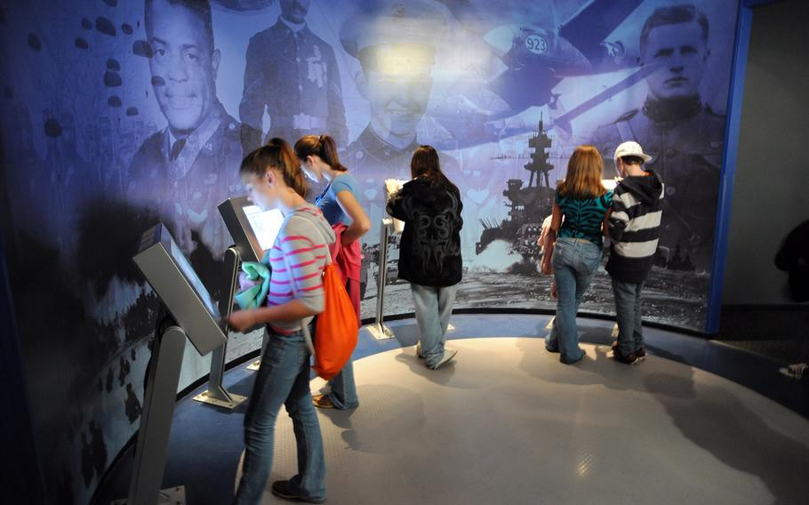 Guests look at interactive exhibits at the Medal of Honor Museum aboard the USS Yorktown at Patriots Point, S.C.