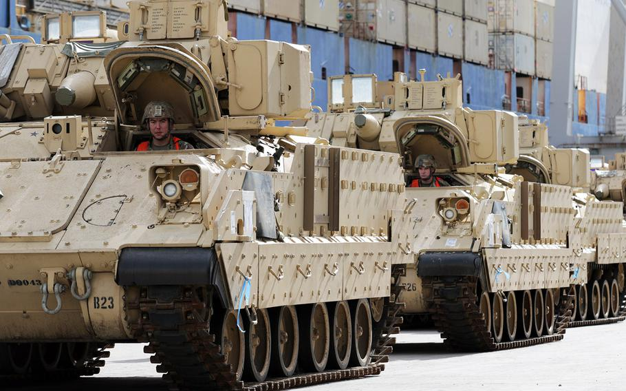 In a Feb. 7, 2020 photo, U.S. Army M2 Bradleys wait to be loaded onto American Roll-On Roll-Off Carrier Endurance in Savannah, Ga., for DEFENDER Europe-20. The Army's 2021 budget plan calls for the modernization of the Bradley and other combat vehicles.