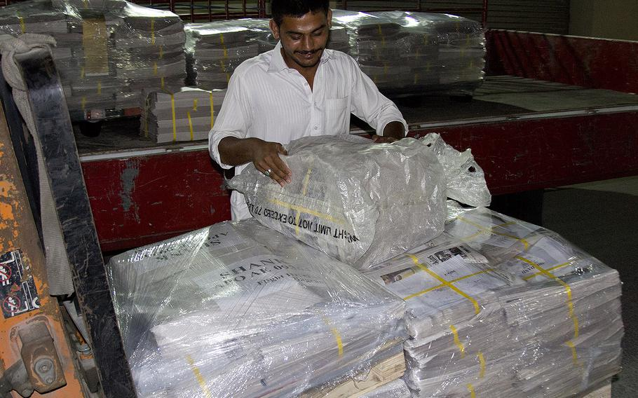 In a 2013 photo, copies of Stars and Stripes destined for service members downrange are packaged at a printing plant in the Middle East.