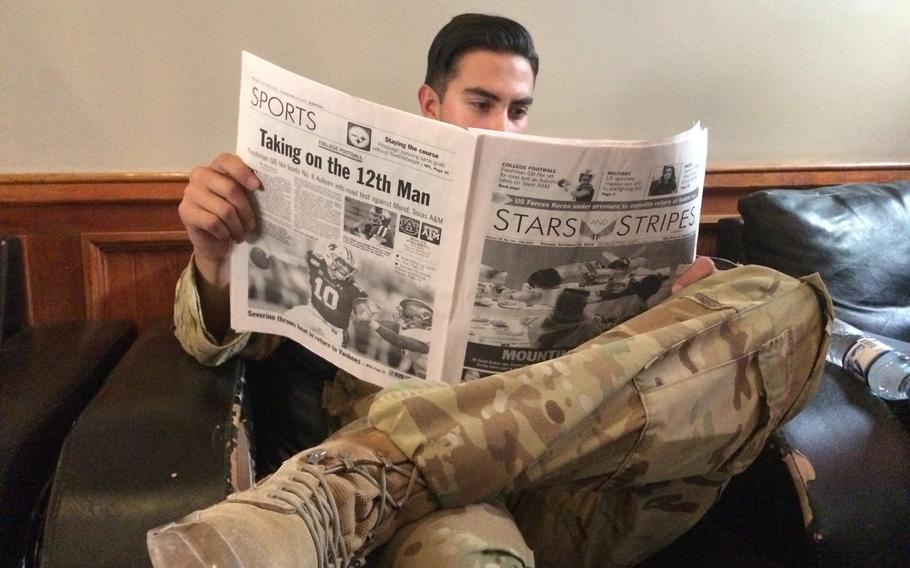 A soldier at Bagram Airfield reads Stars and Stripes while deployed to Afghanistan Sept. 19, 2019.