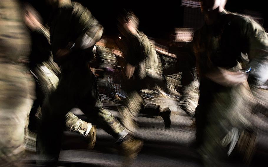 U.S. Army Rangers are seen as a blur as they compete in the eight-mile run during the Best Ranger Competition, Apr. 12, 2019, at Fort Benning, Ga.