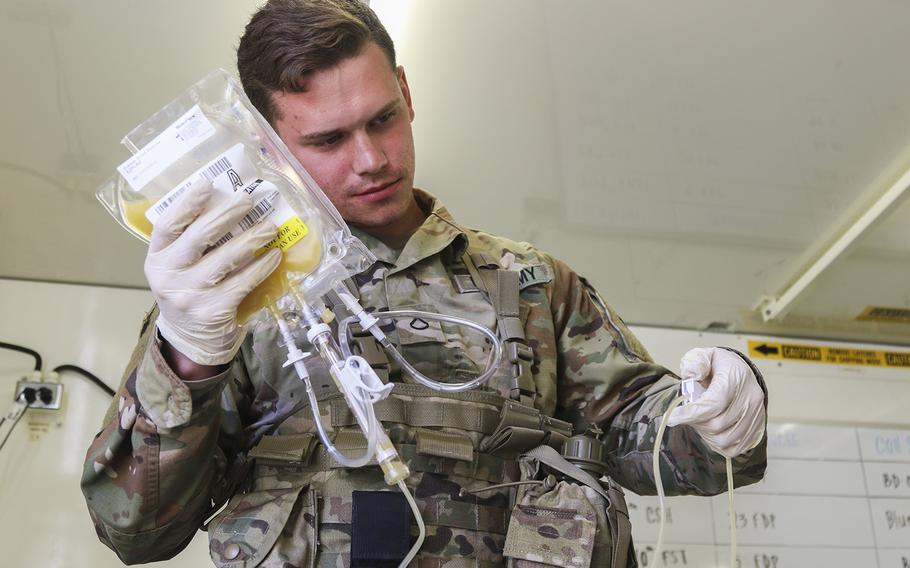 Pfc. Jaritt Louthan, a medical lab technician, works with freeze-dried plasma at Fort Bragg, N.C. The Defense Department announced on Wednesday, Feb. 19, 2020, that of the 50 facilities designated for some level of restructuring, 37 outpatient clinics now open to all beneficiaries will eventually see primarily active-duty personnel.