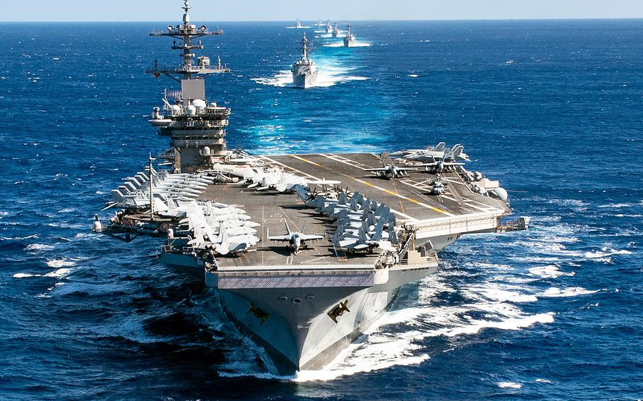 In a Jan. 25, 2020 photo, the Theodore Roosevelt Carrier Strike Group transits in formation in the Pacific Ocean.