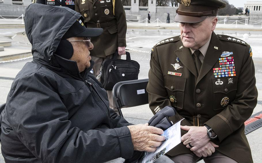 Joint Chiefs of Staff Chairman Gen. Mark Milley talks with World War II veteran Constantine Rizopoulos before an Iwo Jima 75th anniversary ceremony, Feb. 19, 2020 at the National World War II Memorial in Washington, D.C.
