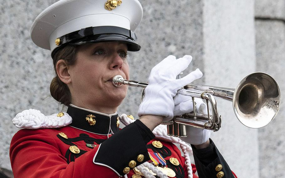 Marine Corps Gunnery Sgt. Amy McCabe plays taps during a ceremony marking the 75th anniversary of the Battle of Iwo Jima, Feb. 19, 2020 at the National World War II Memorial in Washington, D.C.