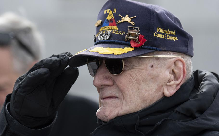 World War II veteran Harry Miller salutes during a ceremony marking the 75th anniversary of the Battle of Iwo Jima, Feb. 19, 2020 at the National World War II Memorial in Washington, D.C.