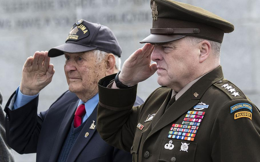 Iwo Jima battle veteran Ira Rigger and Joint Chiefs of Staff Chairman Gen. Mark Milley salute during the playing of the national anthem at a 75th anniversary ceremony, Feb. 19, 2020 at the National World War II Memorial in Washington, D.C.
